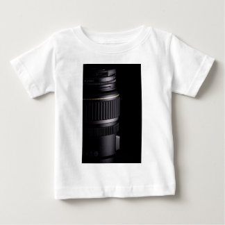 Close up of modern camera lens on black background baby T-Shirt