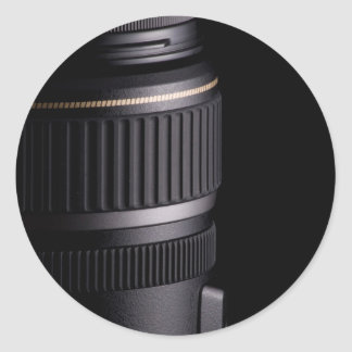 Close up of modern camera lens on black background classic round sticker