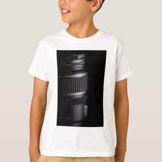 Close up of modern camera lens on black background T-Shirt