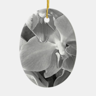 Close up of orchid blossoms in gray scale ceramic ornament