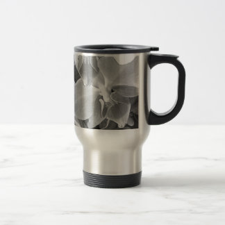Close up of orchid blossoms in gray scale travel mug