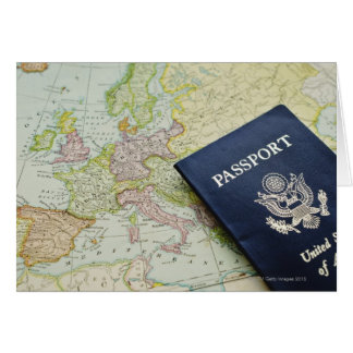 Close-up of passport lying on European map Card
