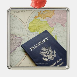 Close-up of passport lying on map Silver-Colored square ornament