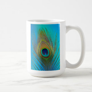 Close up of peacock feather coffee mug