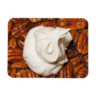 close up of pecan pie with whipped cream magnets