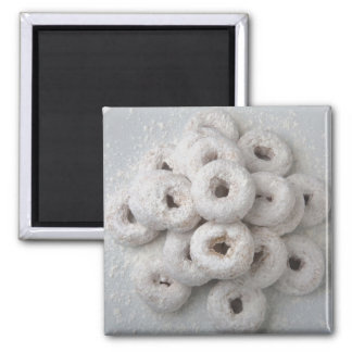 Close-up of powdered doughnuts in a plate square magnet