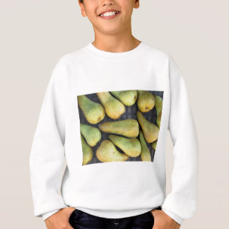 Close-up of ripe pears in box sweatshirt