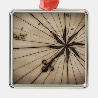 Close up of wind rose on antique map Silver-Colored square ornament