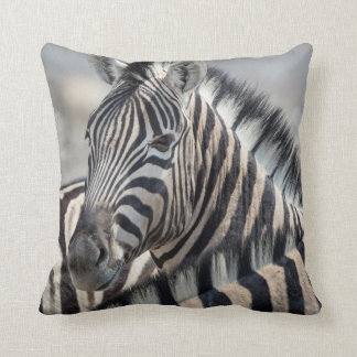 Close-up of zebra head between two other zebras throw pillow