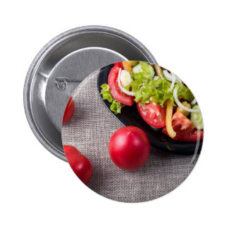 Close-Up top view fresh tomatoes and salad 2 Inch Round Button