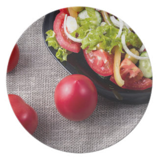 Close-Up top view fresh tomatoes and salad Party Plate