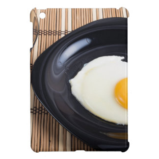 Close-up top view on a black plate with fried egg iPad mini cover