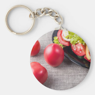 Close-Up top view on fresh tomatoes and a bowl Basic Round Button Keychain