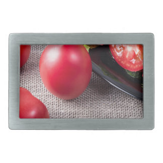 Close-Up top view on fresh tomatoes and a bowl Belt Buckle