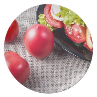 Close-Up top view on fresh tomatoes and a bowl Dinner Plate