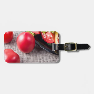 Close-Up top view on fresh tomatoes and a bowl Luggage Tag