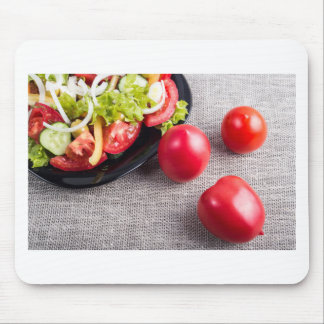 Close-Up top view on fresh tomatoes and a bowl Mouse Pad
