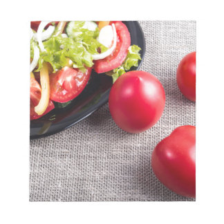 Close-Up top view on fresh tomatoes and a bowl Notepads