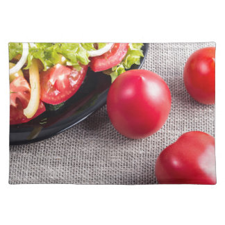 Close-Up top view on fresh tomatoes and a bowl Placemats
