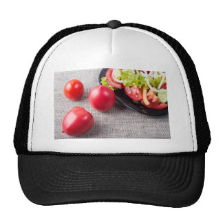Close-Up top view on fresh tomatoes and a bowl Trucker Hat