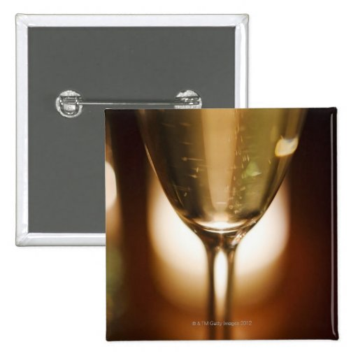 Close-up view of champagne glass pinback buttons