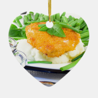 Close-up view of fried chicken ceramic heart ornament