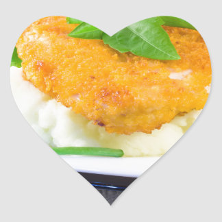 Close-up view of fried chicken heart sticker