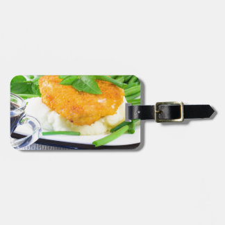 Close-up view of fried chicken luggage tag