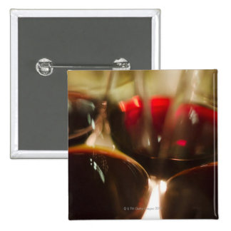 Close-up view of red wine glasses pinback buttons