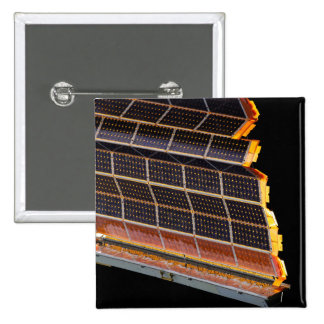 Close-up view of the solar arrays 2 inch square button