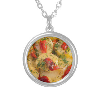 Close up view on a vegetarian dish of potatoes silver plated necklace