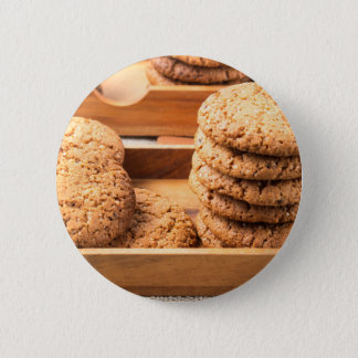 Close-up view on oat biscuits in wooden boxes 2 inch round button