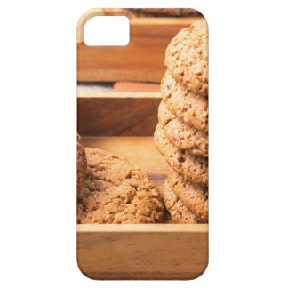 Close-up view on oat biscuits in wooden boxes case for the iPhone 5