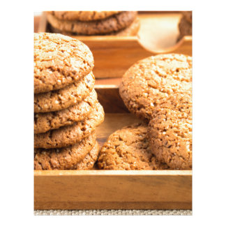 Close-up view on oat biscuits in wooden boxes customized letterhead