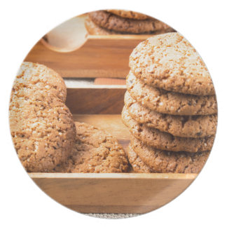 Close-up view on oat biscuits in wooden boxes dinner plate