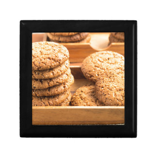 Close-up view on oat biscuits in wooden boxes gift box