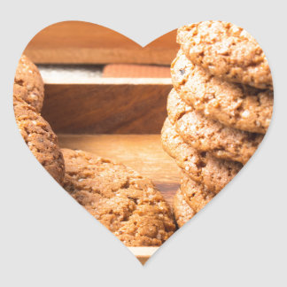 Close-up view on oat biscuits in wooden boxes heart sticker