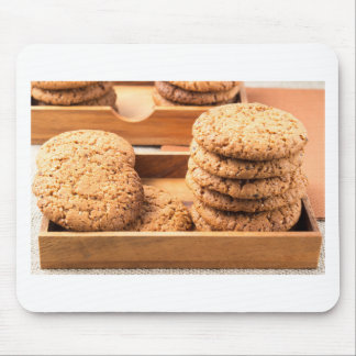Close-up view on oat biscuits in wooden boxes mouse pad
