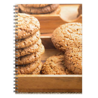 Close-up view on oat biscuits in wooden boxes notebooks