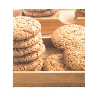 Close-up view on oat biscuits in wooden boxes notepad