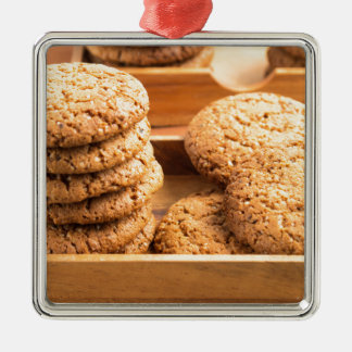 Close-up view on oat biscuits in wooden boxes Silver-Colored square ornament