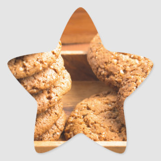 Close-up view on oat biscuits in wooden boxes star sticker