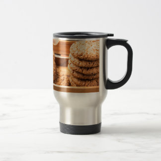 Close-up view on oat biscuits in wooden boxes travel mug
