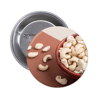 Close Up view on raw cashew nuts for vegetarian 2 Inch Round Button