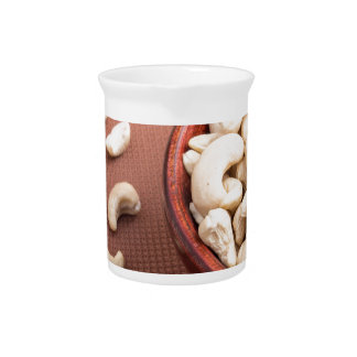 Close Up view on raw cashew nuts for vegetarian Beverage Pitchers
