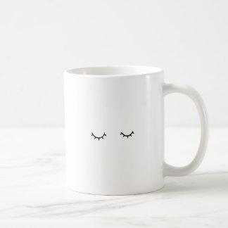 Closed eyes, just eyelashes coffee mug
