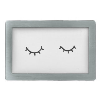 Closed eyes, just eyelashes rectangular belt buckles