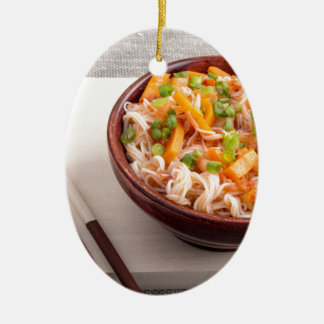 Closeup Asian dish of rice noodles and vegetable Ceramic Oval Ornament