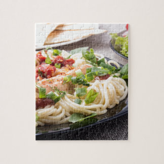 Closeup black plate with spaghetti puzzle