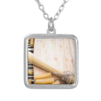 Closeup food background on the kitchen table silver plated necklace